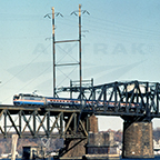 AEM-7 leading a train over the Susquehanna River, 1980s.