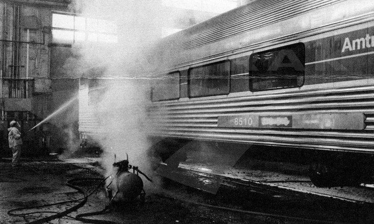 Car No. 8510 receives an acid-foam wash, 1980.