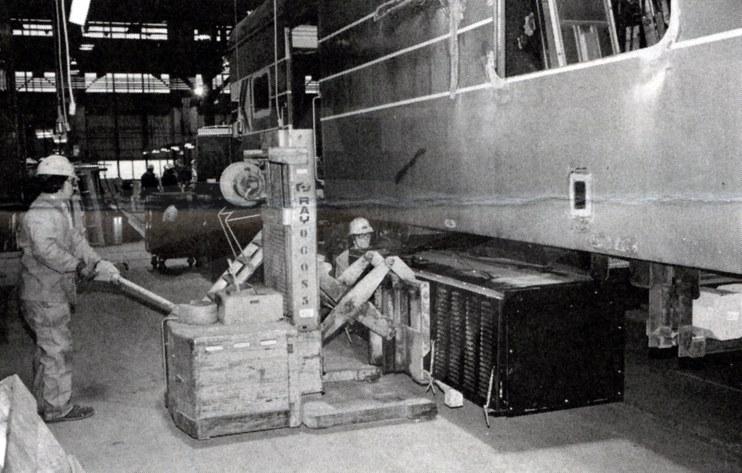 Carmen-welders working on a dining car, 1980.