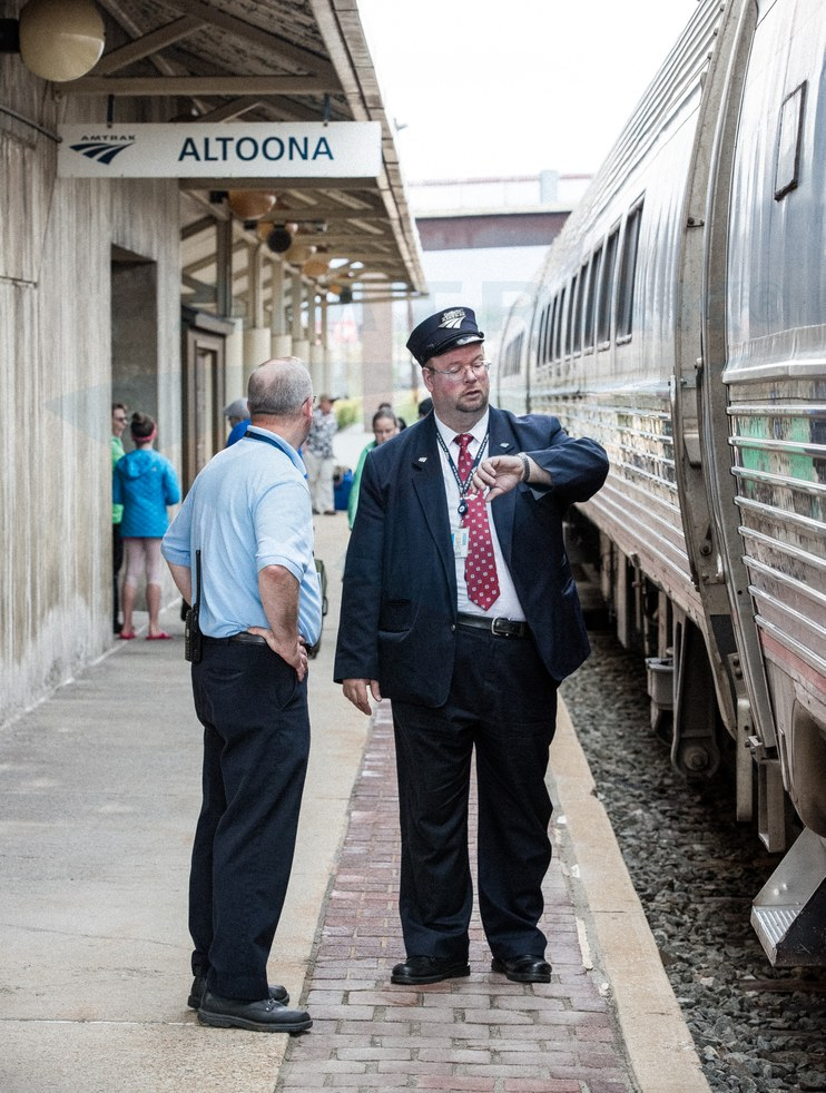 Conductor checking his watch, 2016.