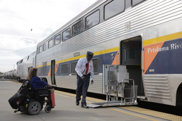 Conductor helping a passenger, 2015.