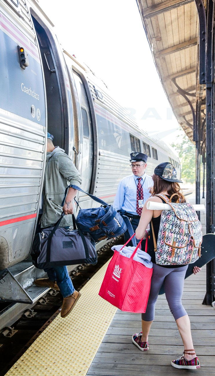 Assistant conductor helping passengers board the <i>Vermonter</i>, 2015.