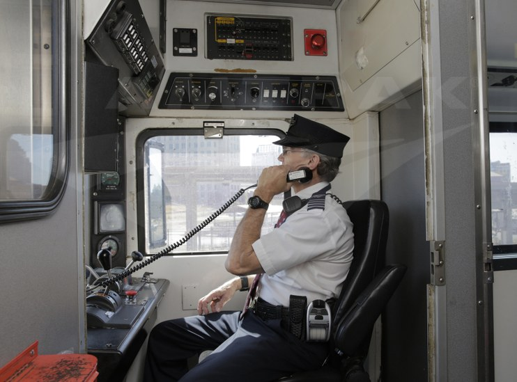 Conductor making an announcement, 2015.