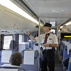 Conductor placing a seat check, 2015.