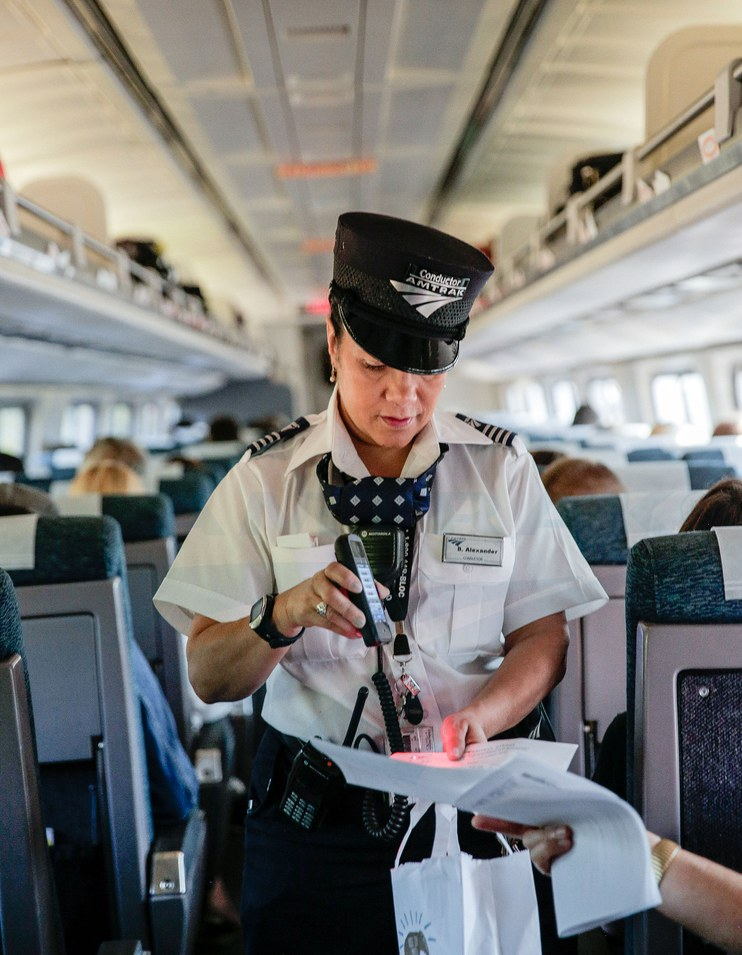 Conductor scanning tickets on the <i>Vermonter</i>, 2015.