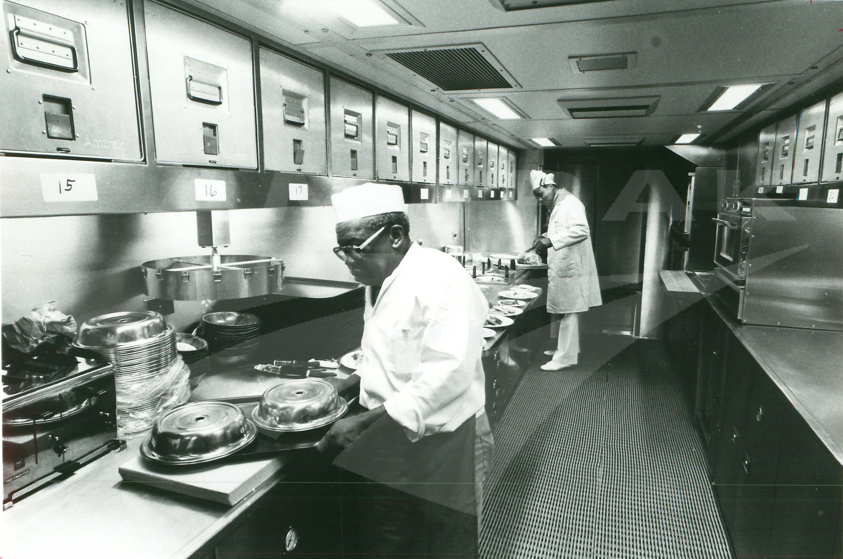 Cooks in a Superliner kitchen. — Amtrak: History of America\'s Railroad