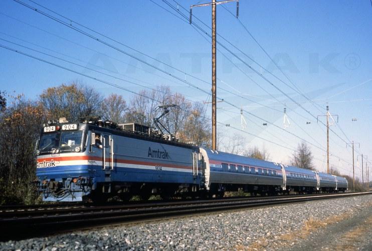 AEM-7 locomotive No. 904 pulling Amfleet II cars, 1980s.