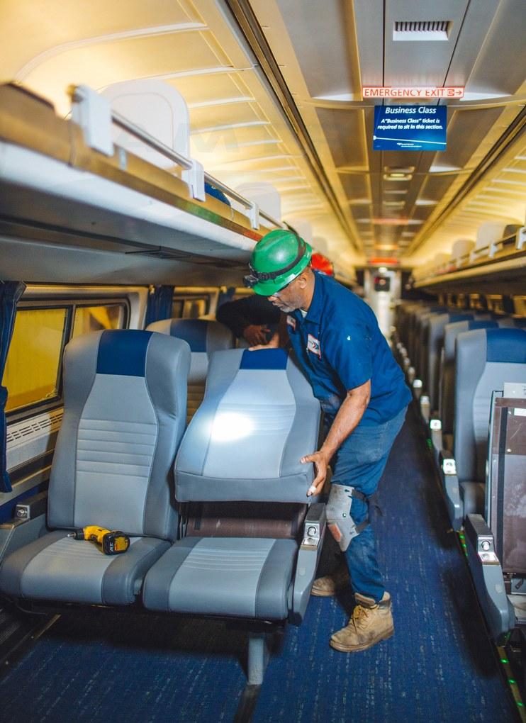 Installing new cushions on coach car No. 81535, 2017.