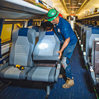 Installing new cushions on coach car No. 81535, 2017.
