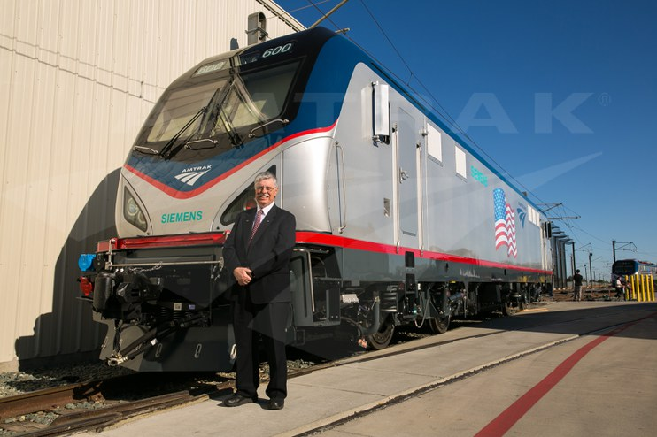 Joseph Boardman with a new ACS-64 locomotive, 2013.