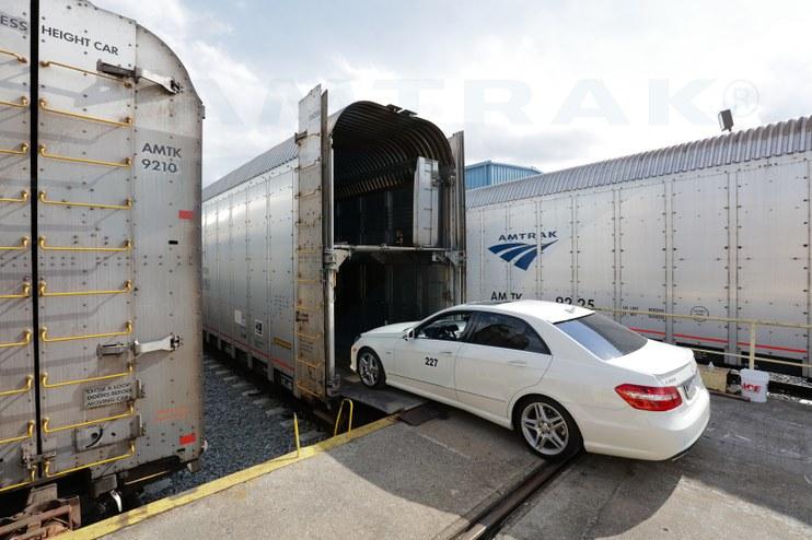 Loading a car onto an auto carrier, 2016.