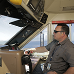 Locomotive engineer operating a <i>Capitol Corridor</i> train, 2015.