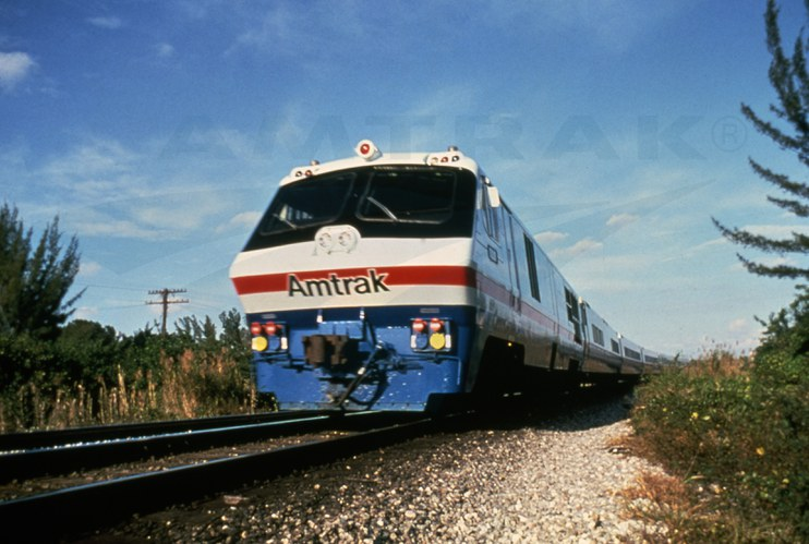 Amtrak train in autumn landscape
