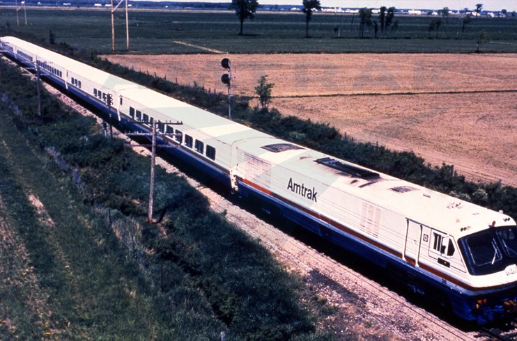 LRC train traveling through the countryside, 1980s.