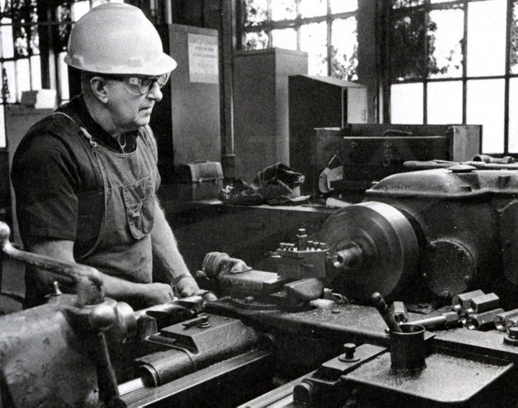 Machinist making brass nuts at Beech Grove, 1980.