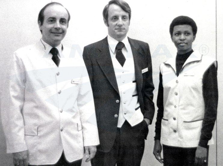Employees modeling new uniforms, 1977.