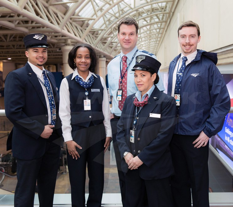 Onboard and Station Services employees modeling uniforms, 2014.
