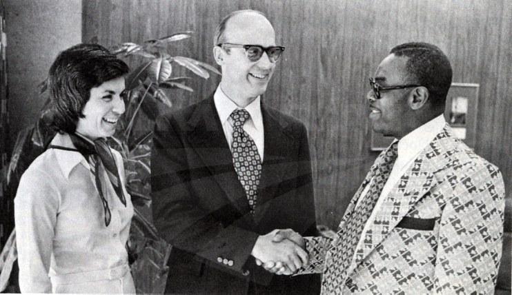 Paul Reistrup congratulating employees, 1977.