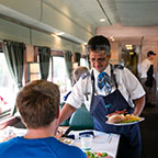 Service attendant at work in a Heritage dining car, 2015.