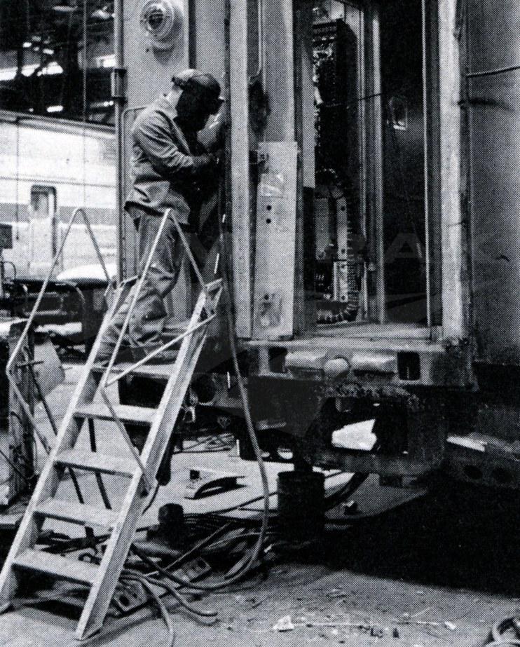 Welder working on a bulkhead at Beech Grove, 1980.
