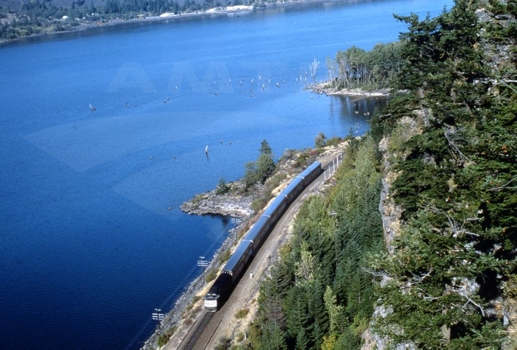 Western long-distance train along a river, 1980s.