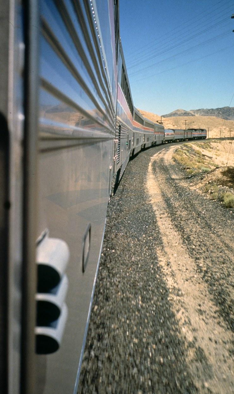 Western long-distance train in a desert landscape, 1980s.