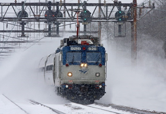 AEM-7 No. 928 leads a train through Croydon, Pa., in the winter of 2009.