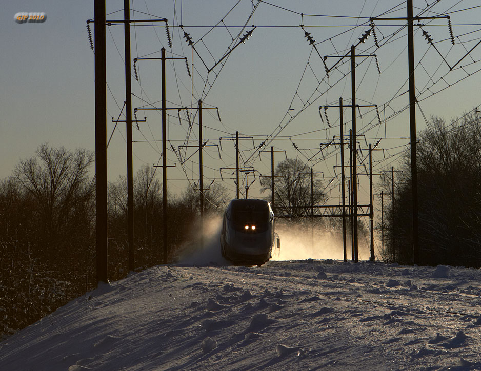 Acela Express at Bristol, Pa., kicking up snow.