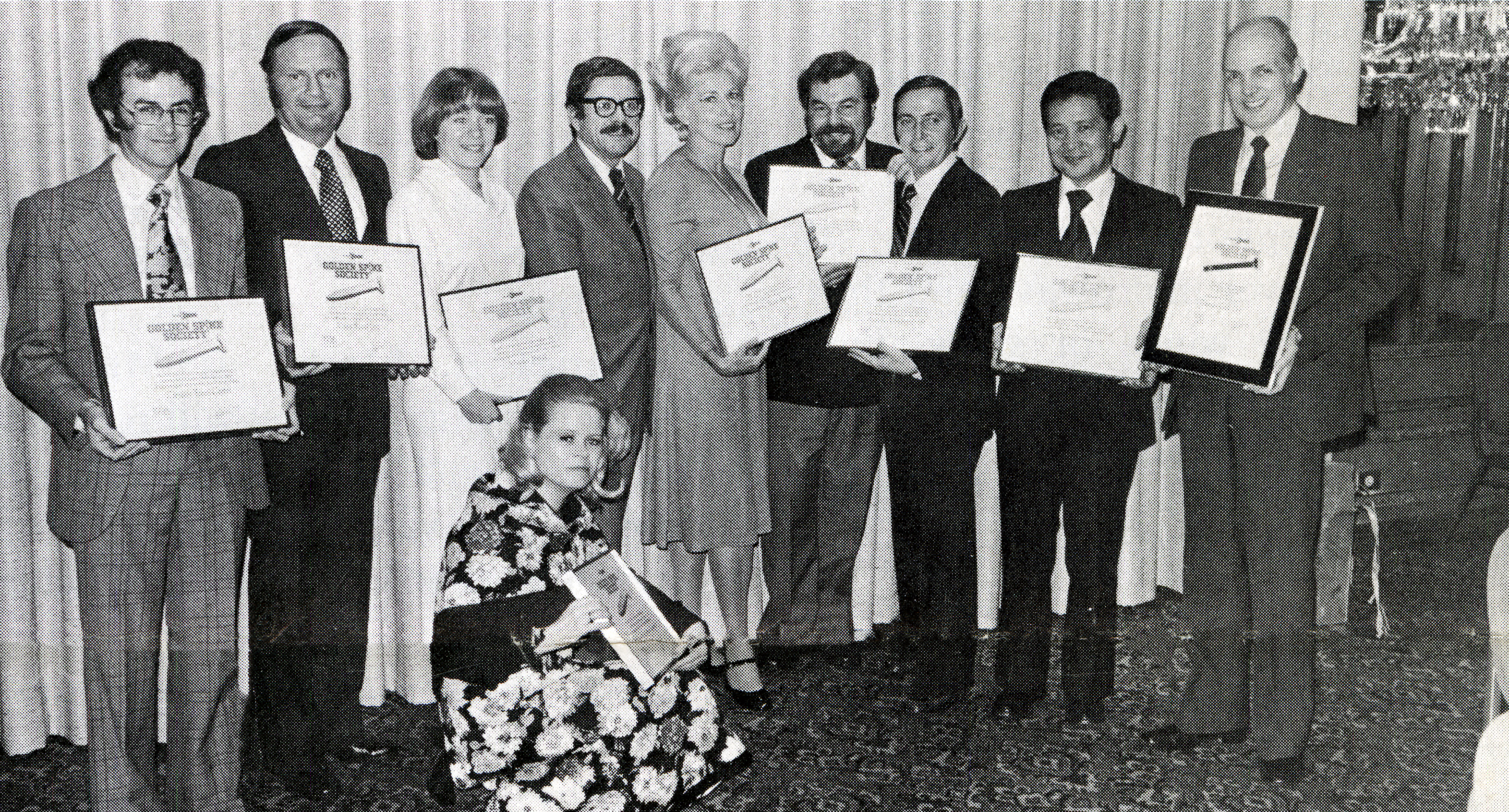 Foreign travel agents are inducted into the Golden Spike Society, 1977