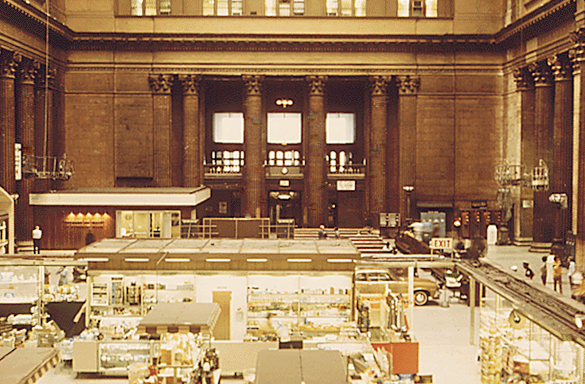 Amtrak consolidated all Chicago-area services at Union Station in 1972. This 1974 image shows the main hall populated by various displays as well as passenger seating. Image by Charles O'Rear, courtesy of the National Archives.