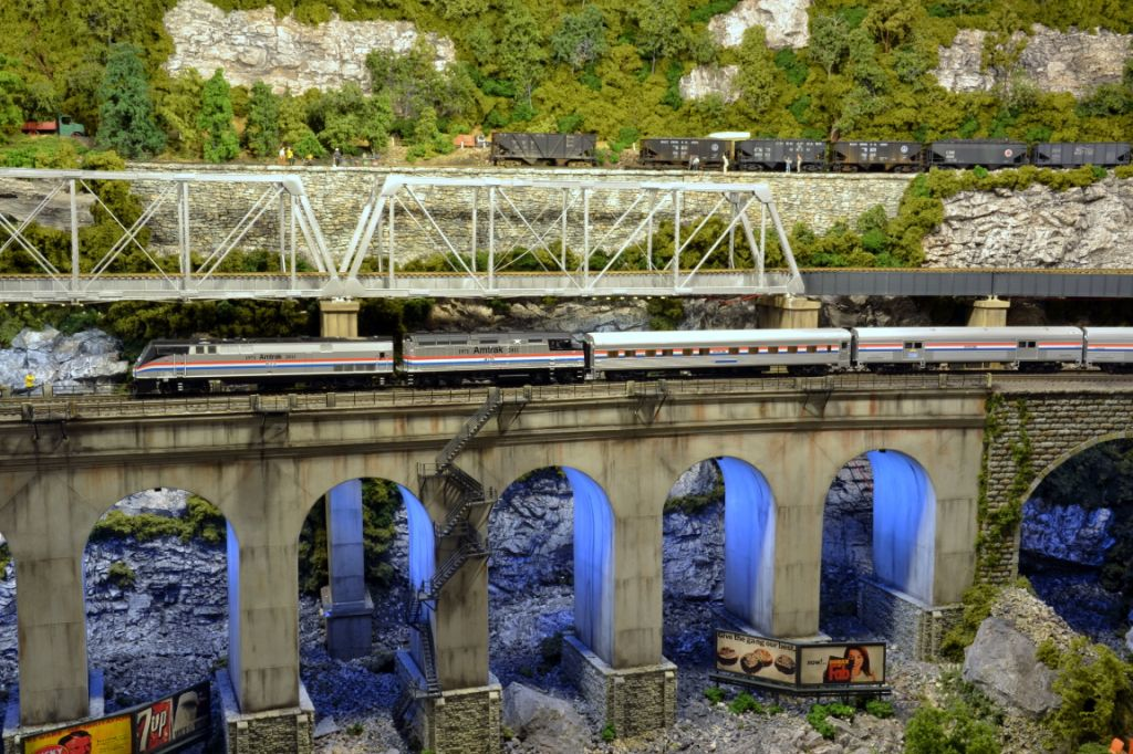 Our model Exhibit Train passes over a deep gorge on its way to its next stop.