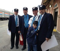 Conductors and friend at the Exhibit Train