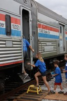 Visitors climb onto the Exhibit Train at Charleston, S.C.