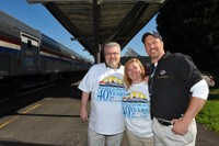 Engineer Dan Russell, Mary Russell, and Engineer and 40th Anniversary team member Steve Ostrowski pose on the Raleigh platform