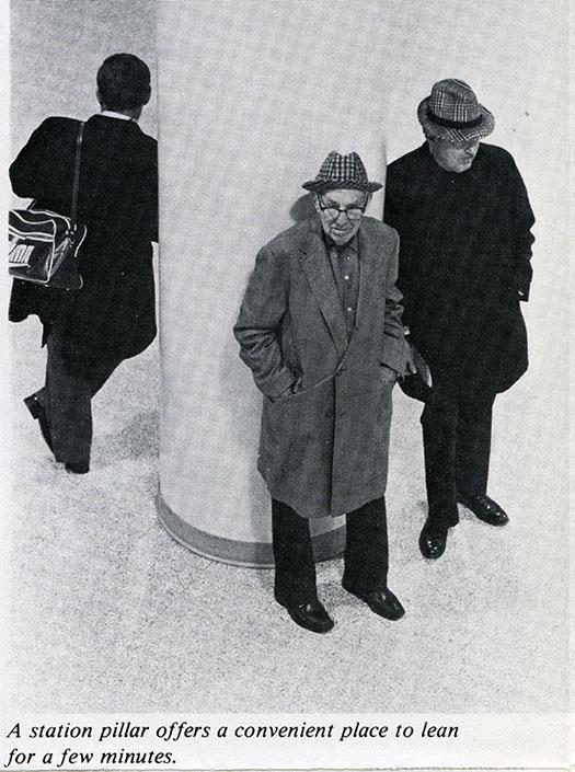 Men leaning against a pillar at Washington Union Station, 1977.