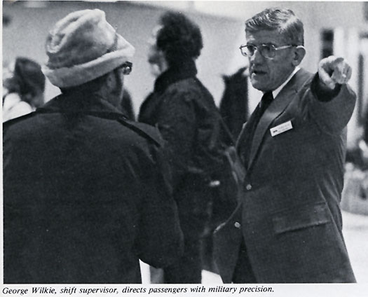 Shift Supervisor at Washington Union Station helping a customer, 1977.